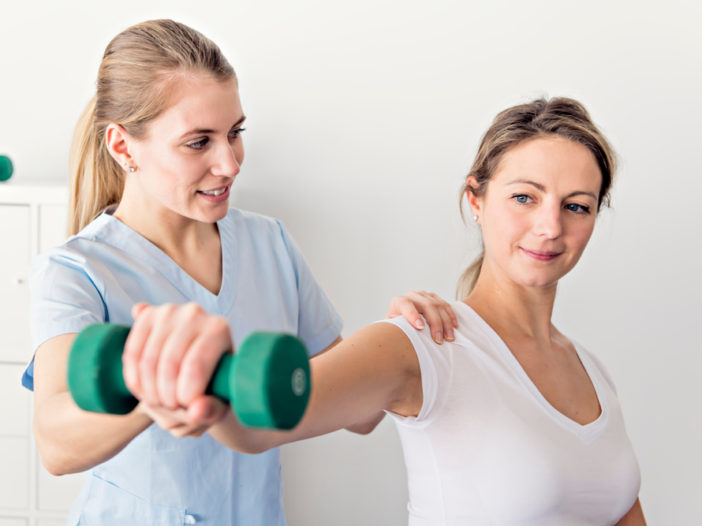 Physiotherapist showing how to fix shoulder pain